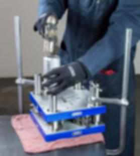 Tool and die maker manufacturing custom precision metal stamping die