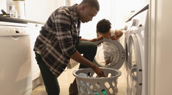 iStock-1129667981-dad-and-kid-laundry