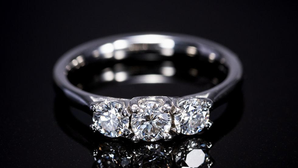 Round Brilliant Cut Diamond Three-Stone Ring in Platinum