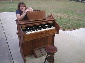 Lori and Becker Reed Organ.jpg