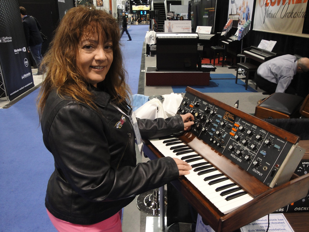 Learning how to play a Moog Synth at NAMM
