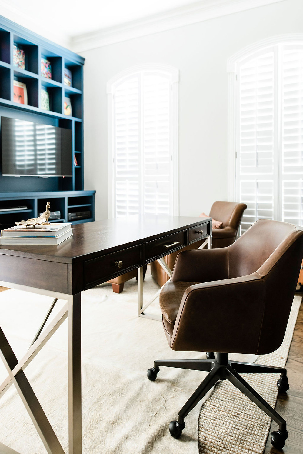 Updated modern transitional work from home office finished by Houston residential design firm Nancy Lane Interiors.
