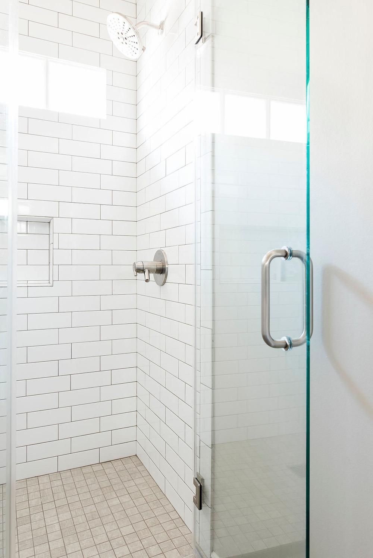 Updated transitional bathroom by Houston interior design firm Nancy Lane Interiors.