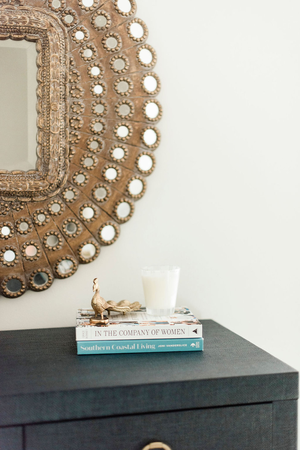 Peacock mirror and object in the studio space of Houston residential design firm Nancy Lane Interiors.