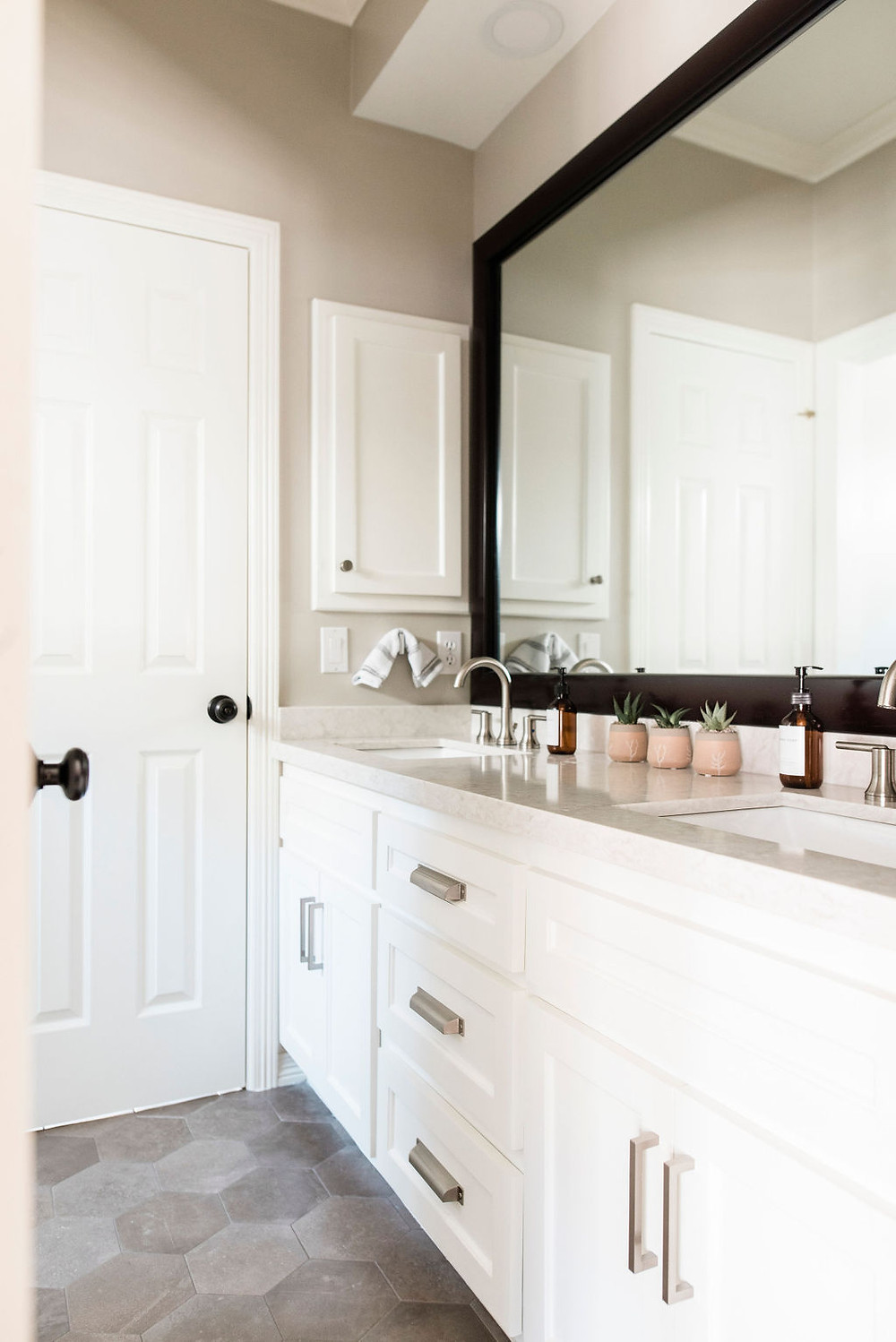 Updated transitional bathroom by Houston interior design firm Nancy Lane Interiors.