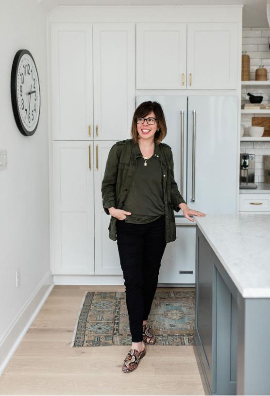 interior designer in white kitchen