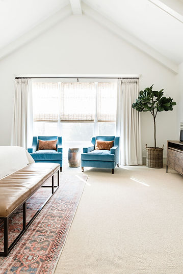 We loved working on this primary bedroom project with our clients who loved the concept of a casual and relaxed modern retreat. Our goal was to design a space that felt like walking into a luxury resort and that would hold up to real life with kids and two sweet pups. I'm happy to report that our client shared that her husband loves this room so much that after dinner he will, more often that not, adjourn here to their new bedroom refuge to relax.