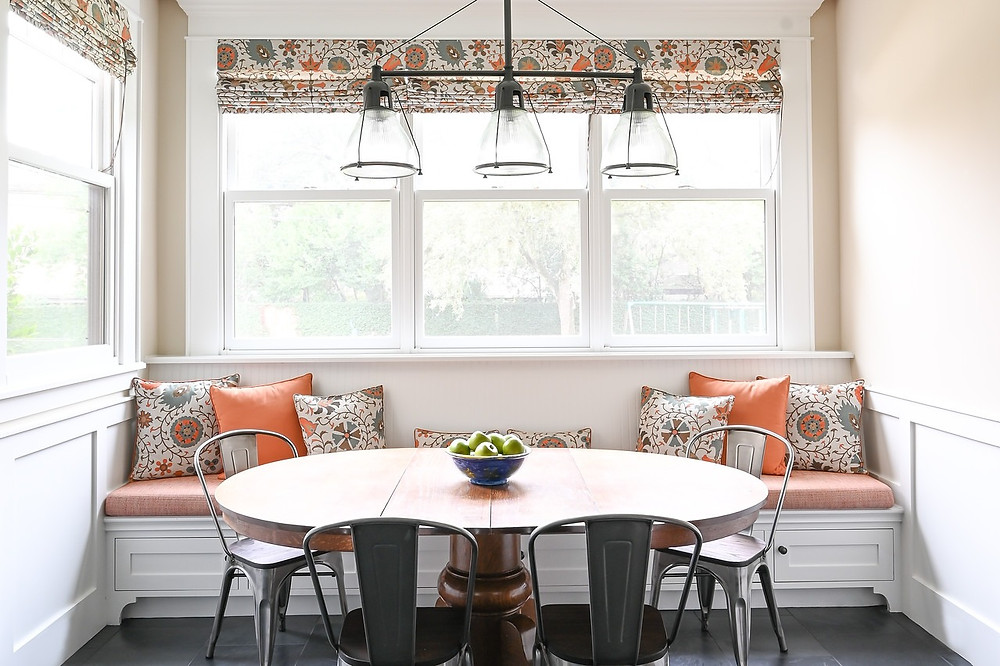 Updated paint scheme in this transitional breakfast nook by Houston residential design firm Nancy Lane Interiors.