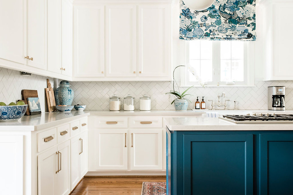 Modern traditional take with a twist on the all white kitchen by Houston residential interior design firm Nancy Lane Interiors.