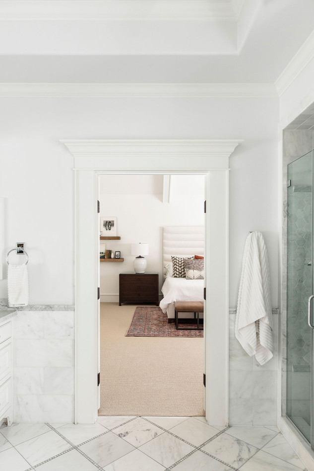 Modern traditional primary bathroom styled by Houston residential interior design firm Nancy Lane Interiors