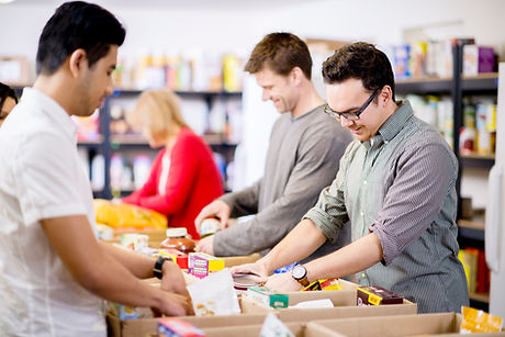 Photo of people filling boxes for a food pantry