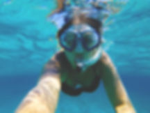 Snorkeling the clear, blue waters