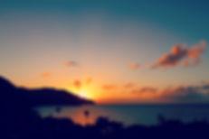 caribbean-sun-sets-behind-island-1637219