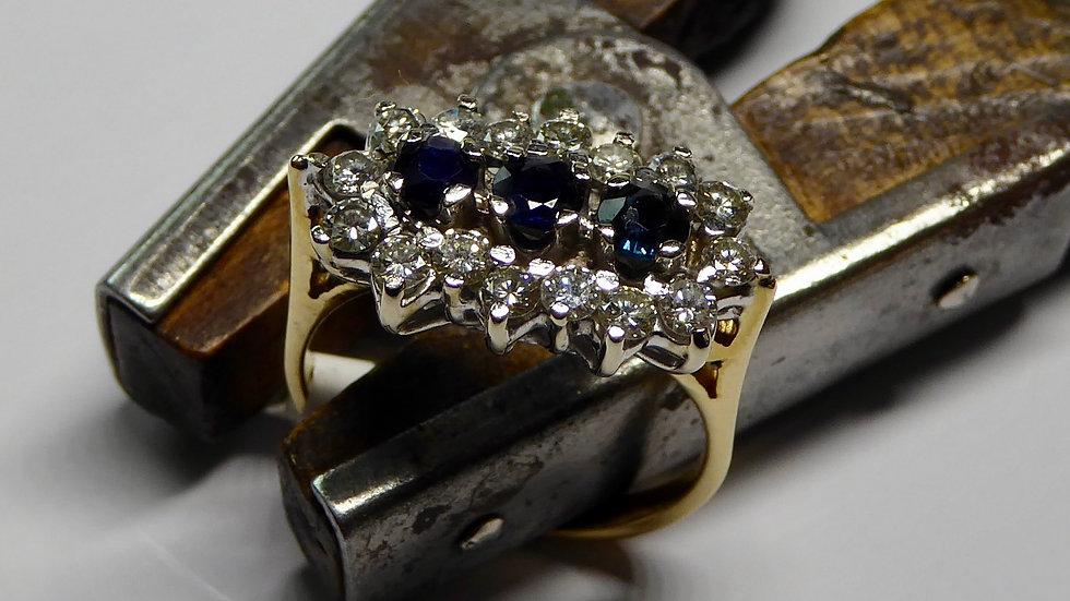 Occasion ring met saffier en diamant, als nieuw