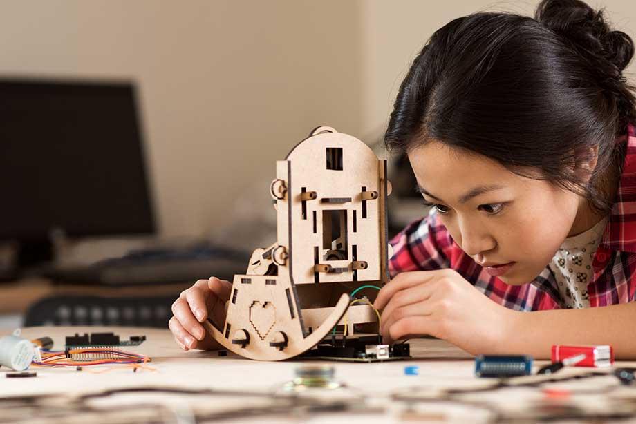 Girl Building a Robot