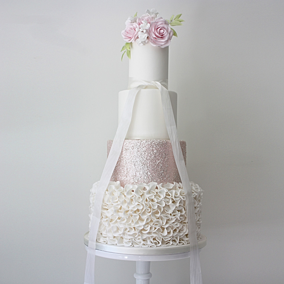 Four tier with ruffles and sparkles