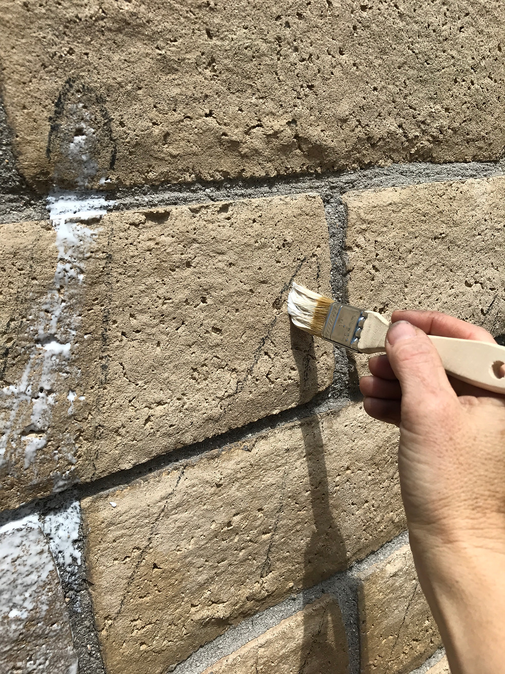 Prepping the wall with a concrete bonding acrylic