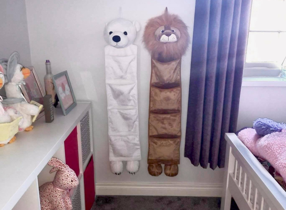 North the Polar Bear & Presley the Lion in twin girl's bedroom.