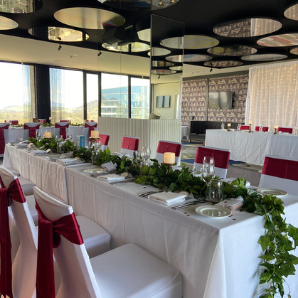 Long tables with greenery & candlesticks