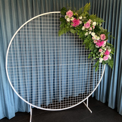 White round mesh wall with faux flowers