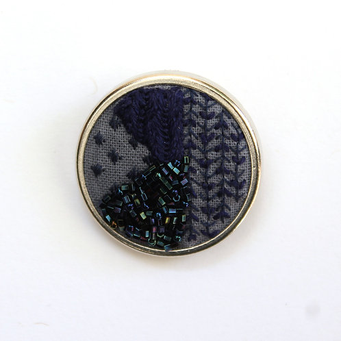 Navy geometric embroidered brooch