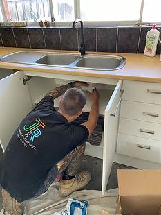 Ryan under sink.jpg