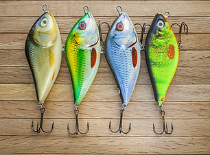 Fishing lures on a wooden background.png