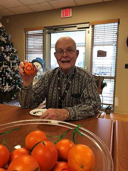 volunteer with oranges