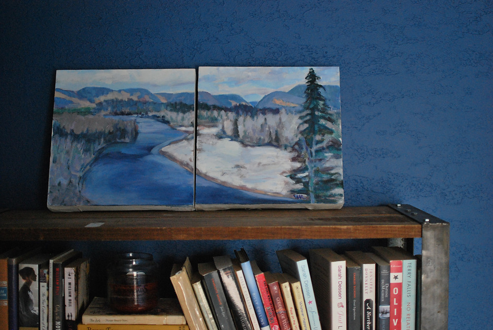 My mother's painting against the freshly painted blue wall, on the bookcase my boyfriend built for me