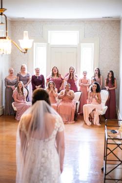 bride Taylor reveals her dress to bridesmaids