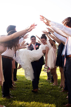 Wedding party greets the newlyweds