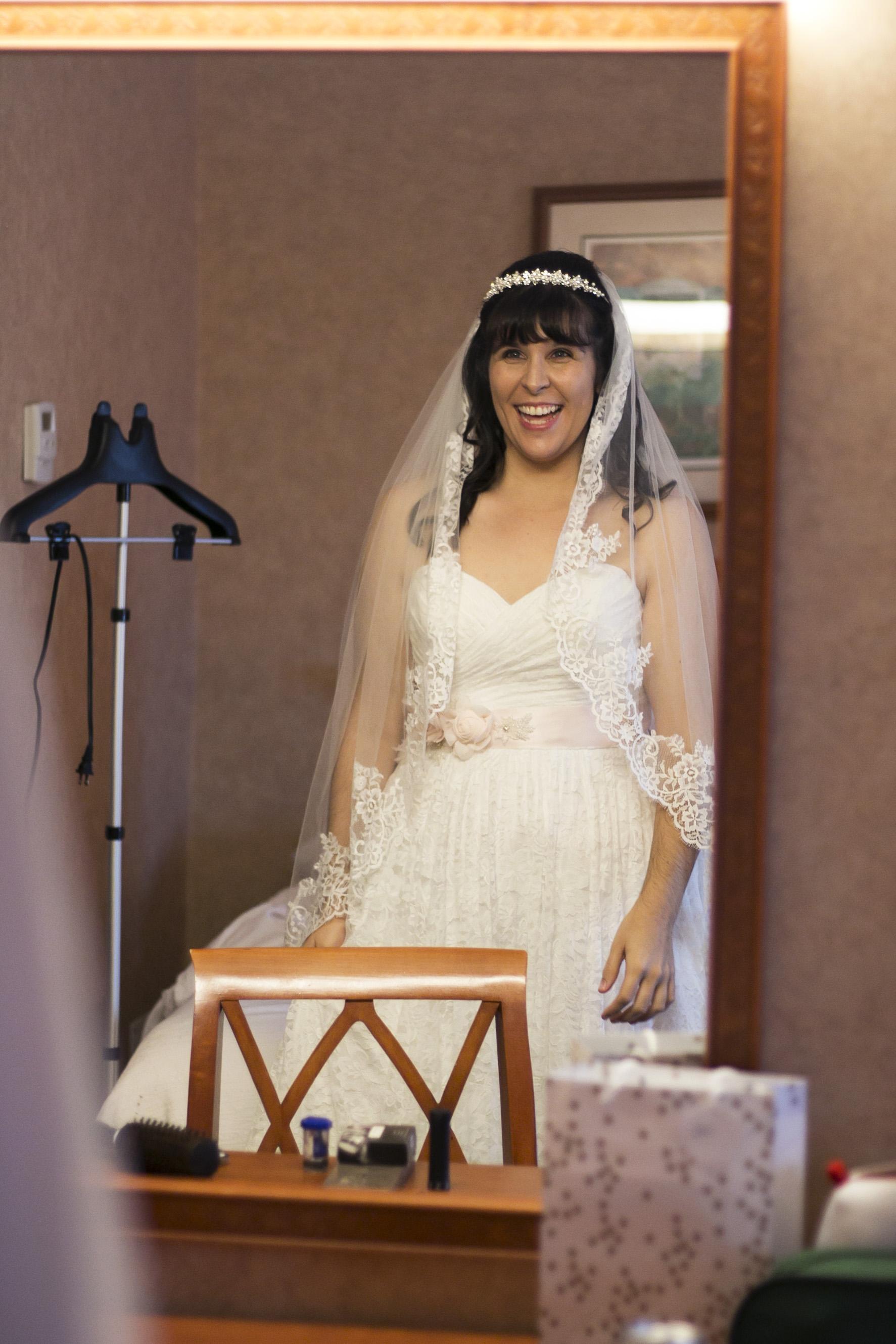 Bride Alisha sees herself in dress