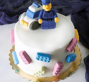 Birthday cake LEGO for baby. White backg