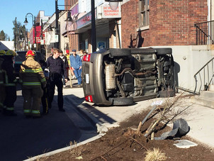 The Record - Vehicle crashes, flips on its side in downtown Mission