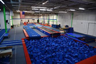 Gymnastics tumble track and foam pit