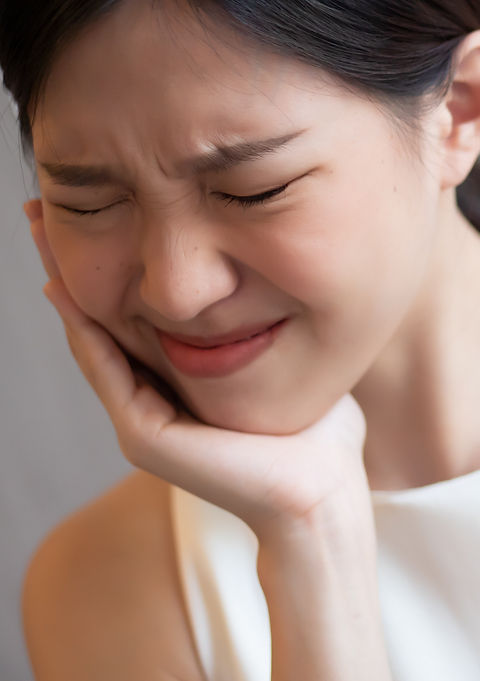 woman with toothache; sick asian woman s
