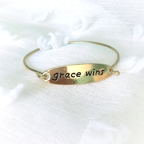 """Grace Wins"" Gold Bangle"