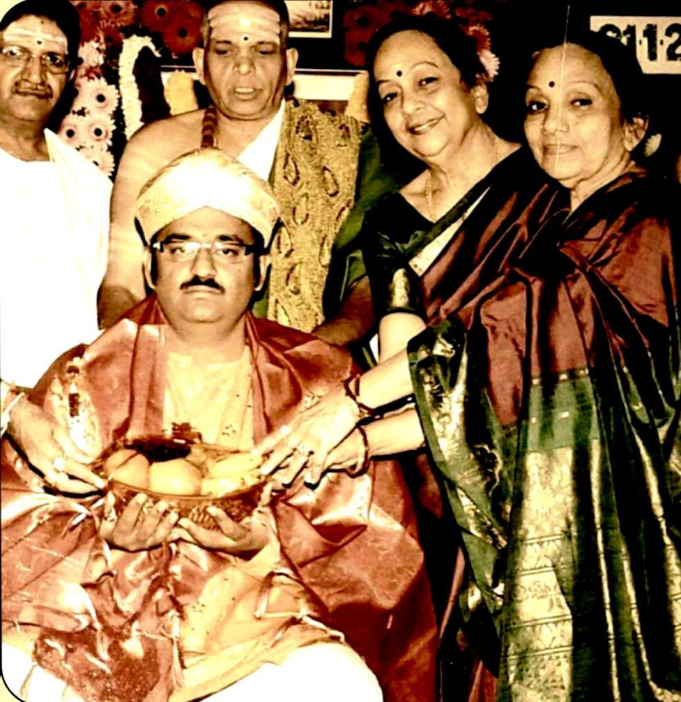 Dr. Nagendra Shastry receiving Nadajyothi puraskar from Bombay Sisters