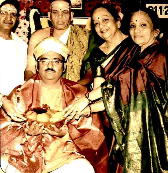 Dr. Nagendra Shastry receiving Nadajyothi puraskar from Bombay Sisters