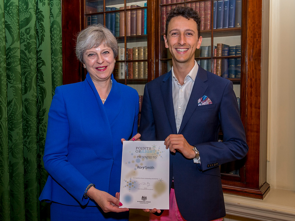 Rory Smith accepting his award from the Prime Minister