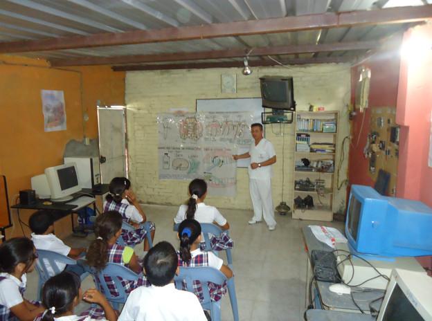 Dr. Daniel Larscheid gives students a talk on dental hygiene at a local school