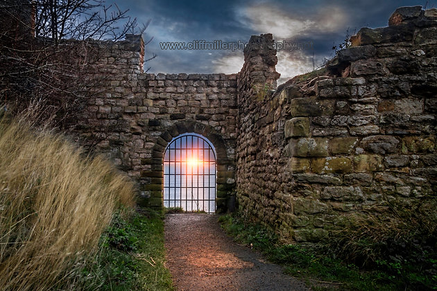 Sunrise through the archway.