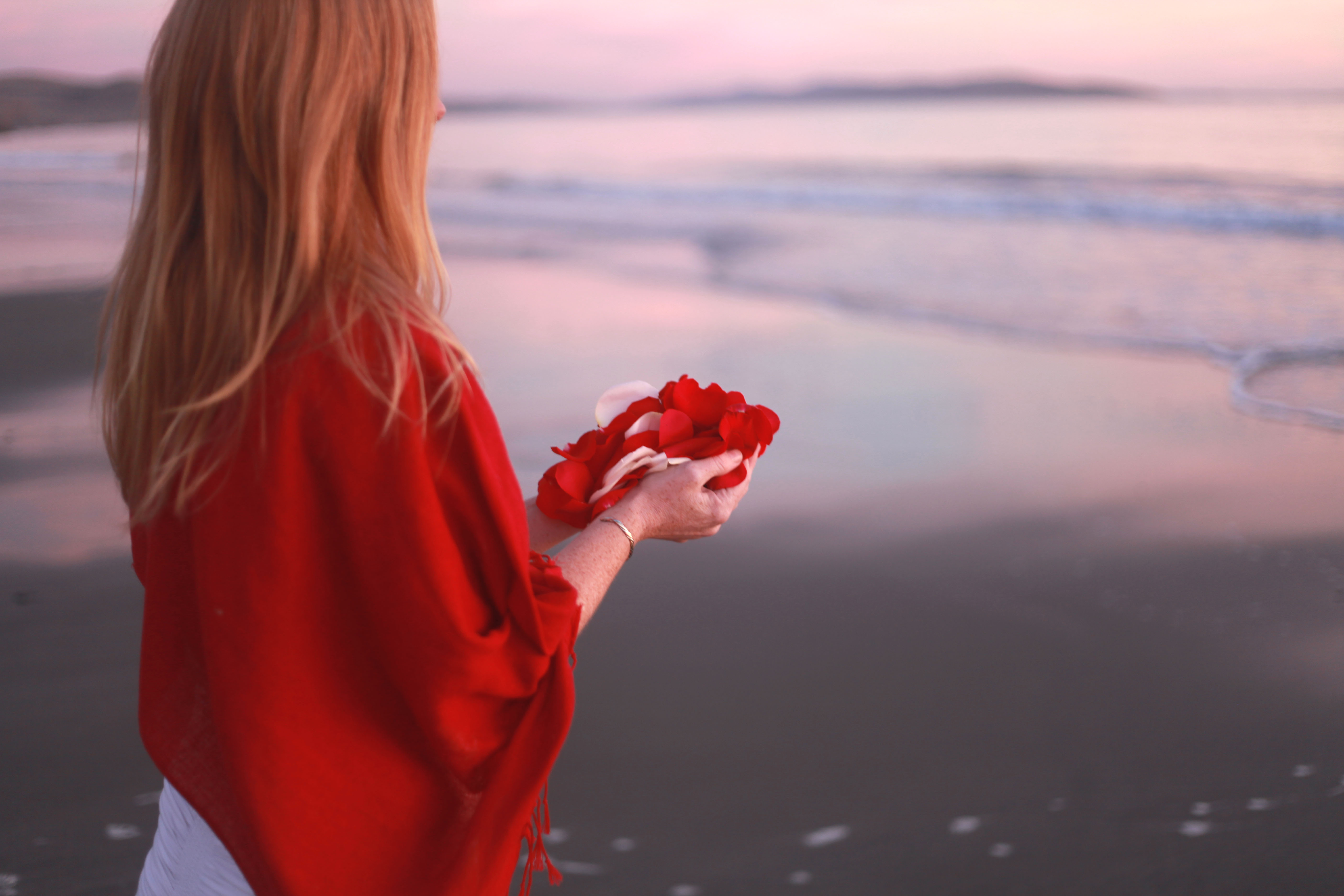 Feather offering to the ocean wide