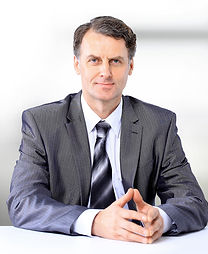 Portrait of a man in suit and tie