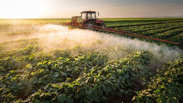 Tractor-spraying-vegetables-Shutterstock
