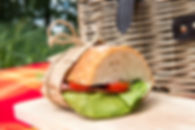 Picnic concept - sandwich on wooden cutting board.jpg