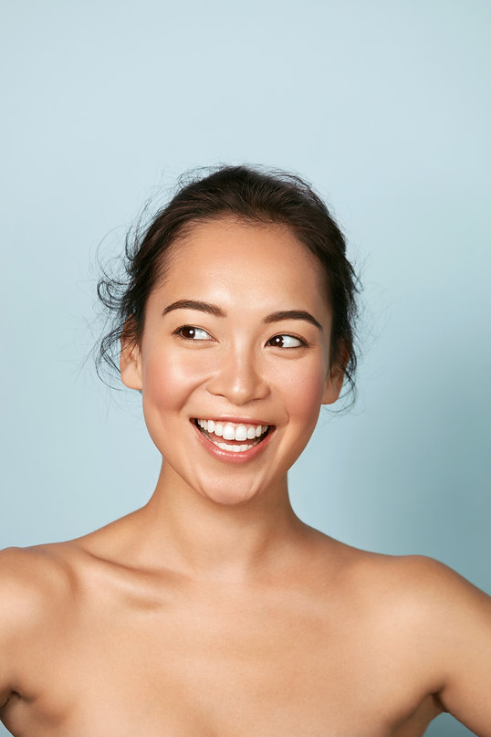 Beauty face. Smiling asian woman with pe