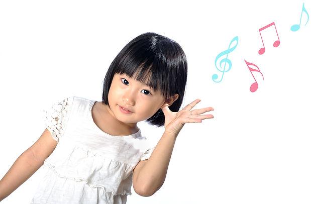 little asian girl touch her ear listenin