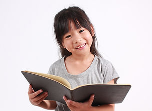 Portrait of young happy girl with book.j