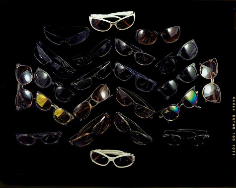 Twenty-Two Pairs of Sunglasses